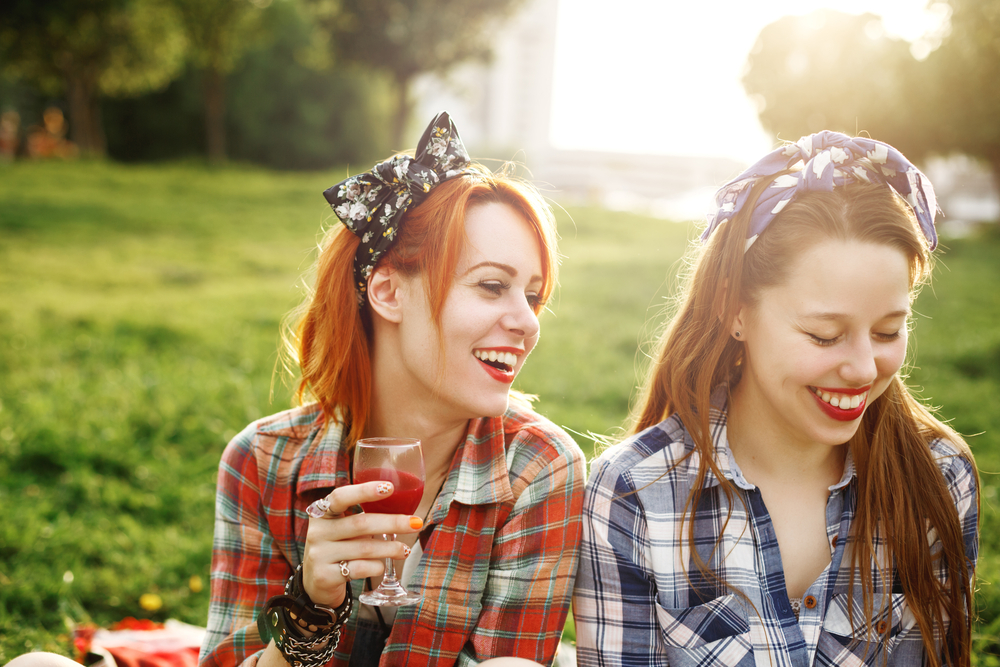 Girls having a drink at a picnic